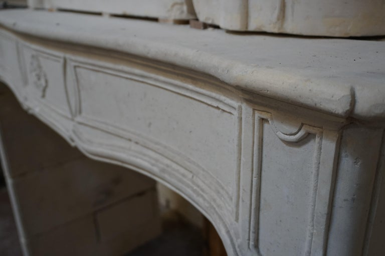 This limestone mantel originates from France during the Louis XV period. Stunning trumeau and well preserved. 