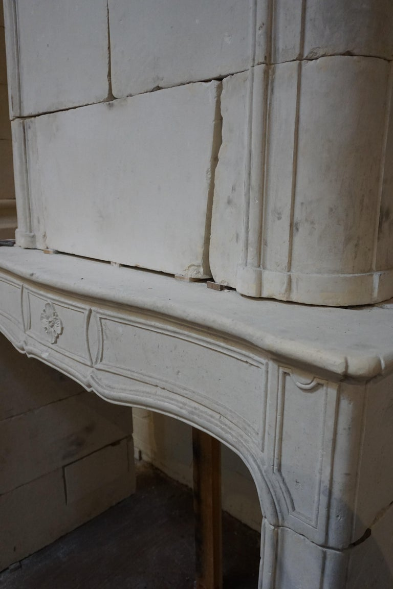 French 18th Century Limestone Mantel with Trumeau For Sale
