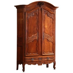18th Century Louis XV Carved Arched Cherry Armoire from Southwest France