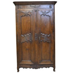 18th Century Louis XV French Provincial Carved Oak Armoire