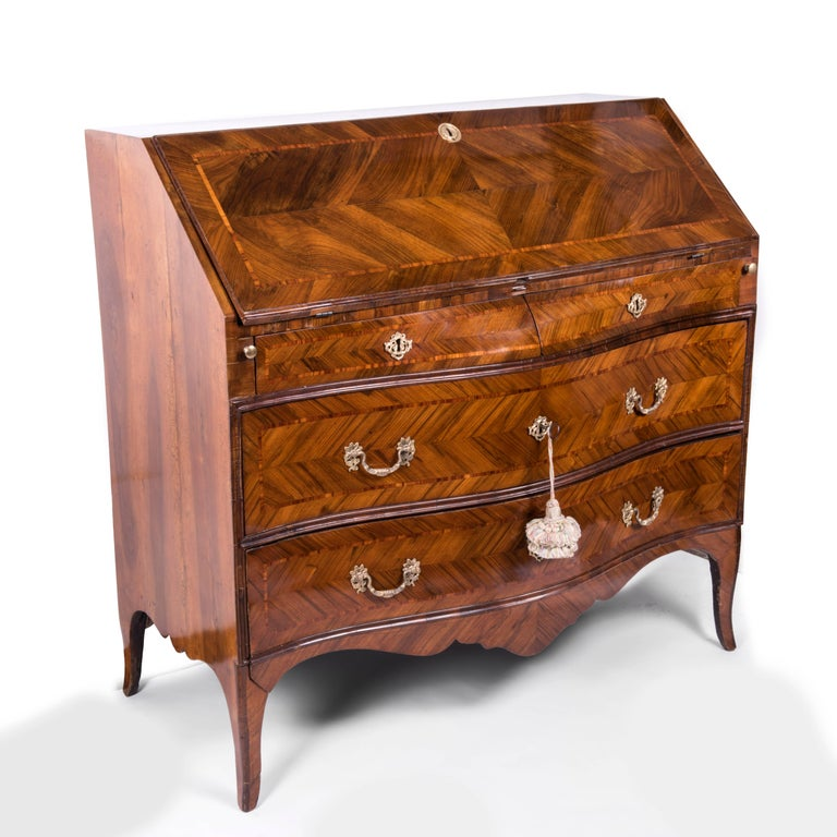An exceptional Italian Genoese walnut veneered and inlaid fall front bureau secretaire desk, dating back to the third quarter of 18th century, of Genoese origin.  The fall opening to a fitted interior of six small drawers, pigeon holes and one
