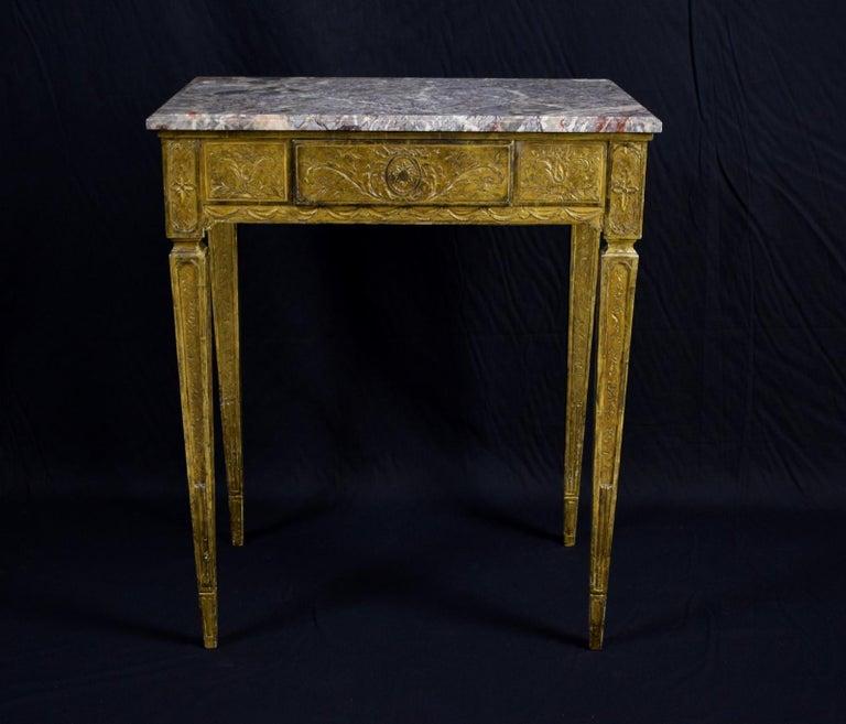 Giltwood center table, Louis XVI period.