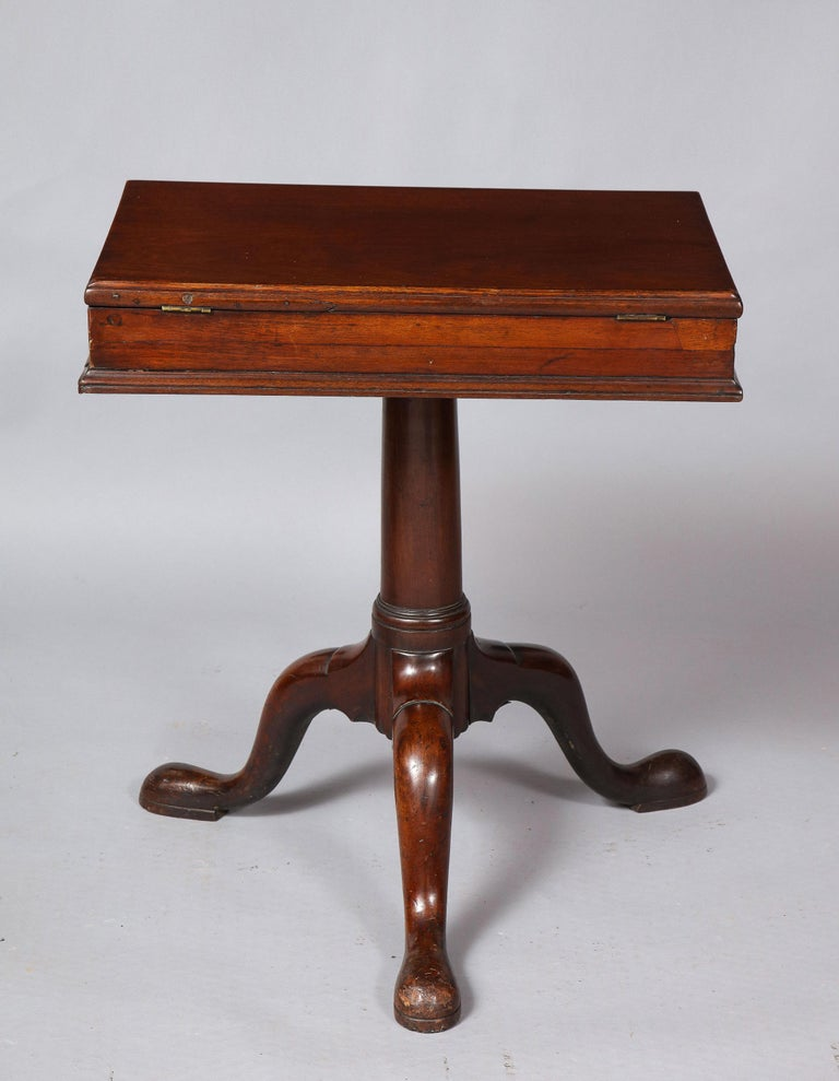 Wonderful and rare George II period solid mahogany library bookstand of excellent proportions having ratcheted adjustable top over two shallow drawers, standing on simple turned column shaft and standing on three cabriole legs ending in slipper