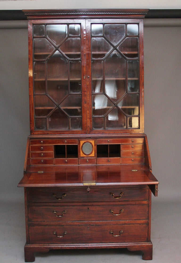 18th century mahogany bureau bookcase with a nice moulded cornice with dentil moulding, the top section having two astrigal glazed doors with three adjustable shelves inside, the bureau fall opening to reveal a lovely fitted interior with various