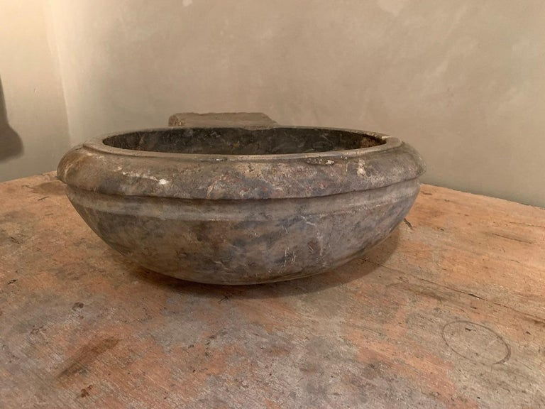 A small 18th century French basin, so called 'benitier'. These were originally used in churches and chapells to contain holy water. Now they make a perfect basin for powder rooms.