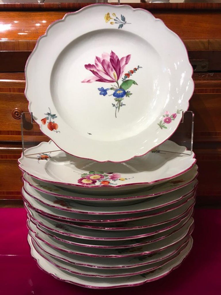 This baroque style dining colorfully dishes set is eclectical and drawn with vibrant colors. The board is in a contemporary fuchsia color.   Precious, fine, elegant and untimeless dining set dishes. The Meissen manufacturer is an antique brand that