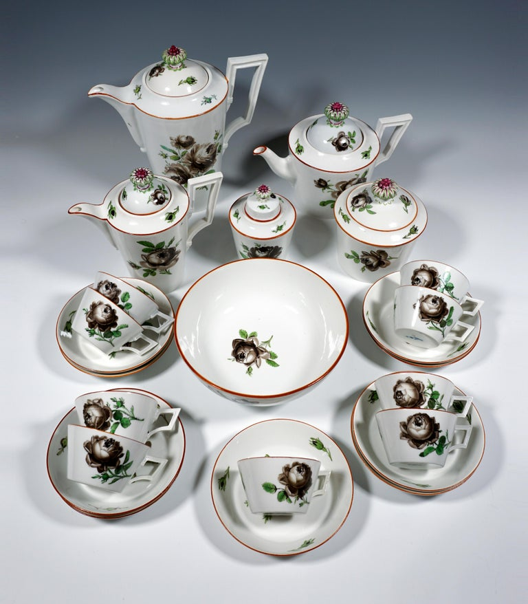 Very early Meissen coffee and tea service, 24 pieces, consisting of a coffee pot with a lid, a teapot with a lid, a milk jug with a lid, a coffee and a tea caddy, as well as a large sugar bowl, nine cups and nine saucers. Smooth conical shape of all