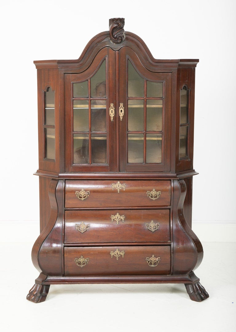 A late 18th century miniature (child's) Dutch kettle base paw foot bookcase with arched crest and glazed double doors and original pulls, circa 1790.