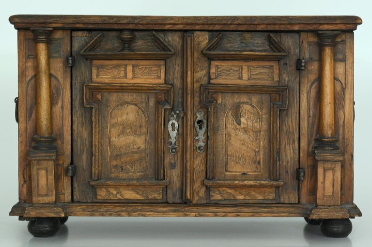 A particularly beautiful example of a model sideboard in the Renaissance style. It is made circa 1750 out of several different woods. The fittings and the lock are original, as well as the interior with the two compartments.