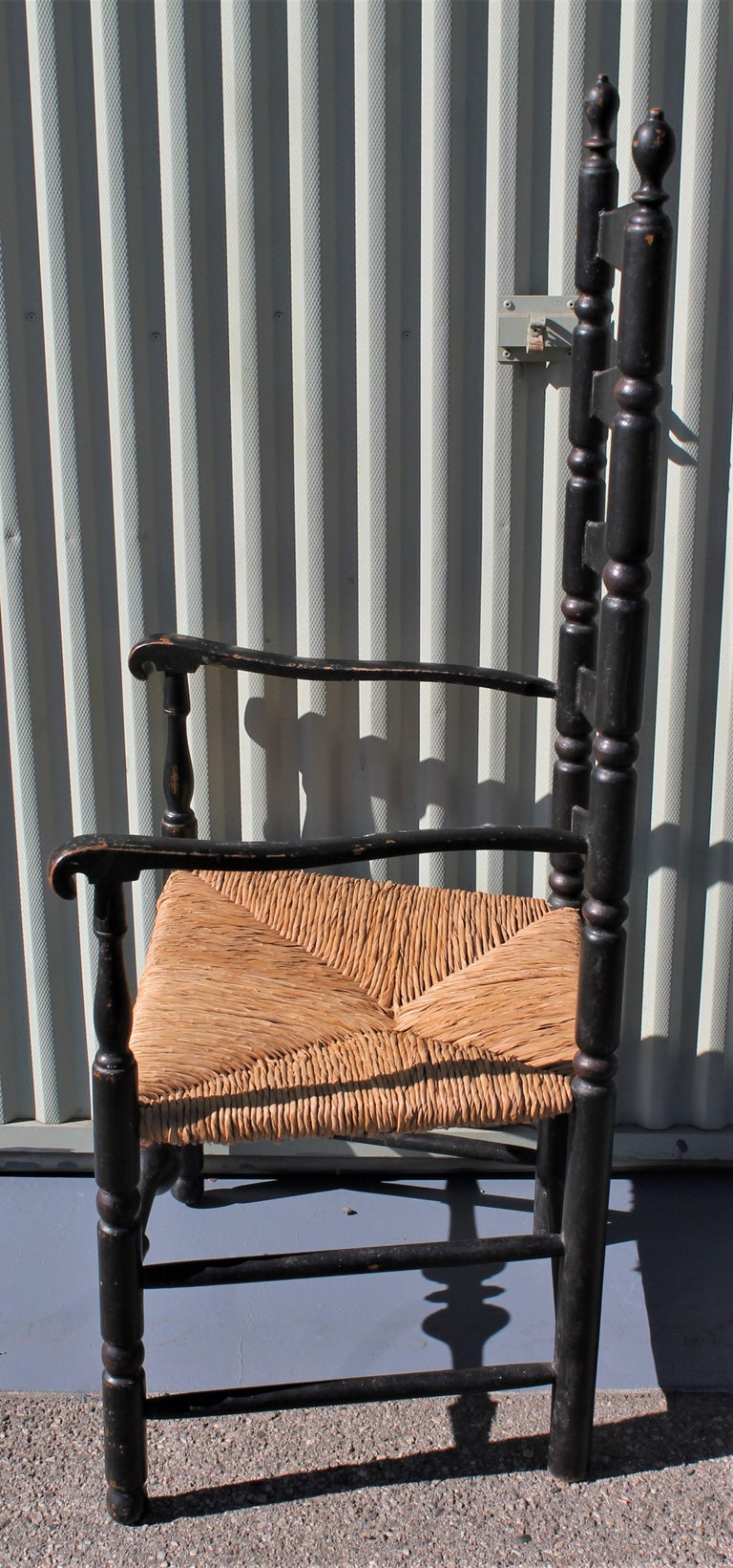 This original black painted 18th century ladder back chair has the original rush painted chair. The chair is in very good condition.