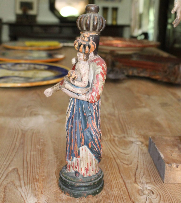 18th century north Spanish polychrome wooden sculpture of the Virgin Mary holding baby Jesus.