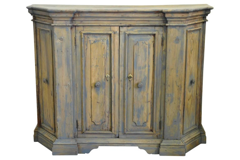 A charming later 18th century credenza from Northern Italy. Wonderfully constructed from pine with a very handsome molded crown over paneled doors.