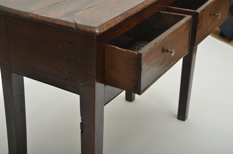 Two-drawer server with straight chamfered legs and brass knobs.