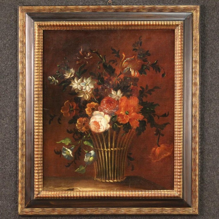 French painting from the late 18th century. Framework oil on canvas depicting still life basket with flowers of good pictorial quality. Painting of nice size and pleasant decor with a modern frame in wood and plaster, chiseled, lacquered and gilded