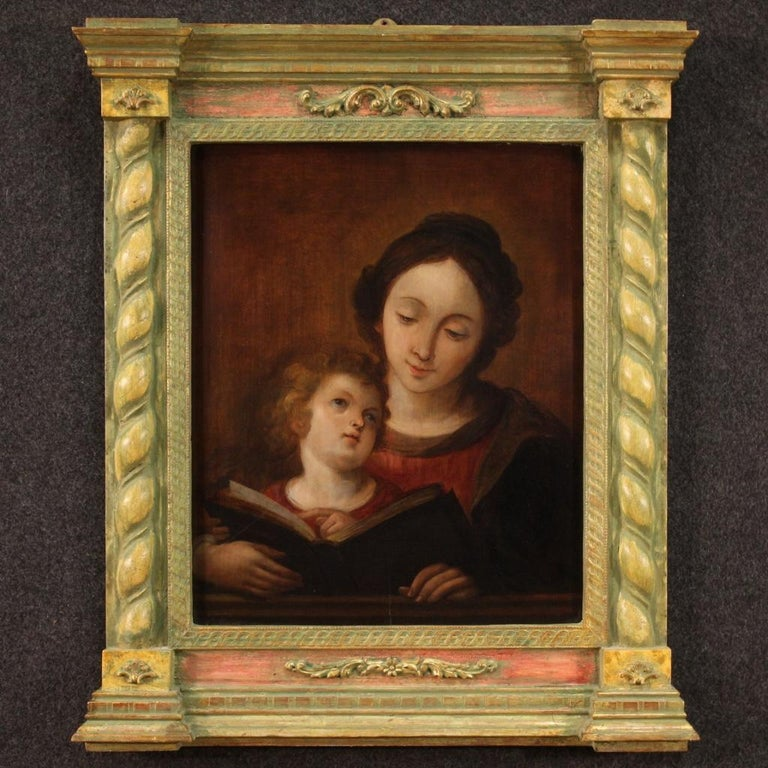 Ancient Italian painting from the first half of the 18th century. Framework oil on panel depicting Education of the Virgin Mary of good pictorial quality. Beautiful painting, for antique dealers, interior decorators and collectors of ancient sacred