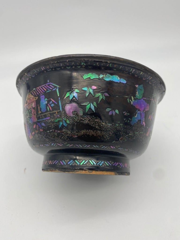 Pair of Chinese silver, lacquer, and mother of pearl big bowls from the 18th century. The faces each of a thin sheet of distressed silver over a body of black lacquered wood with mother of pearl inlays representing traditional style Chinese