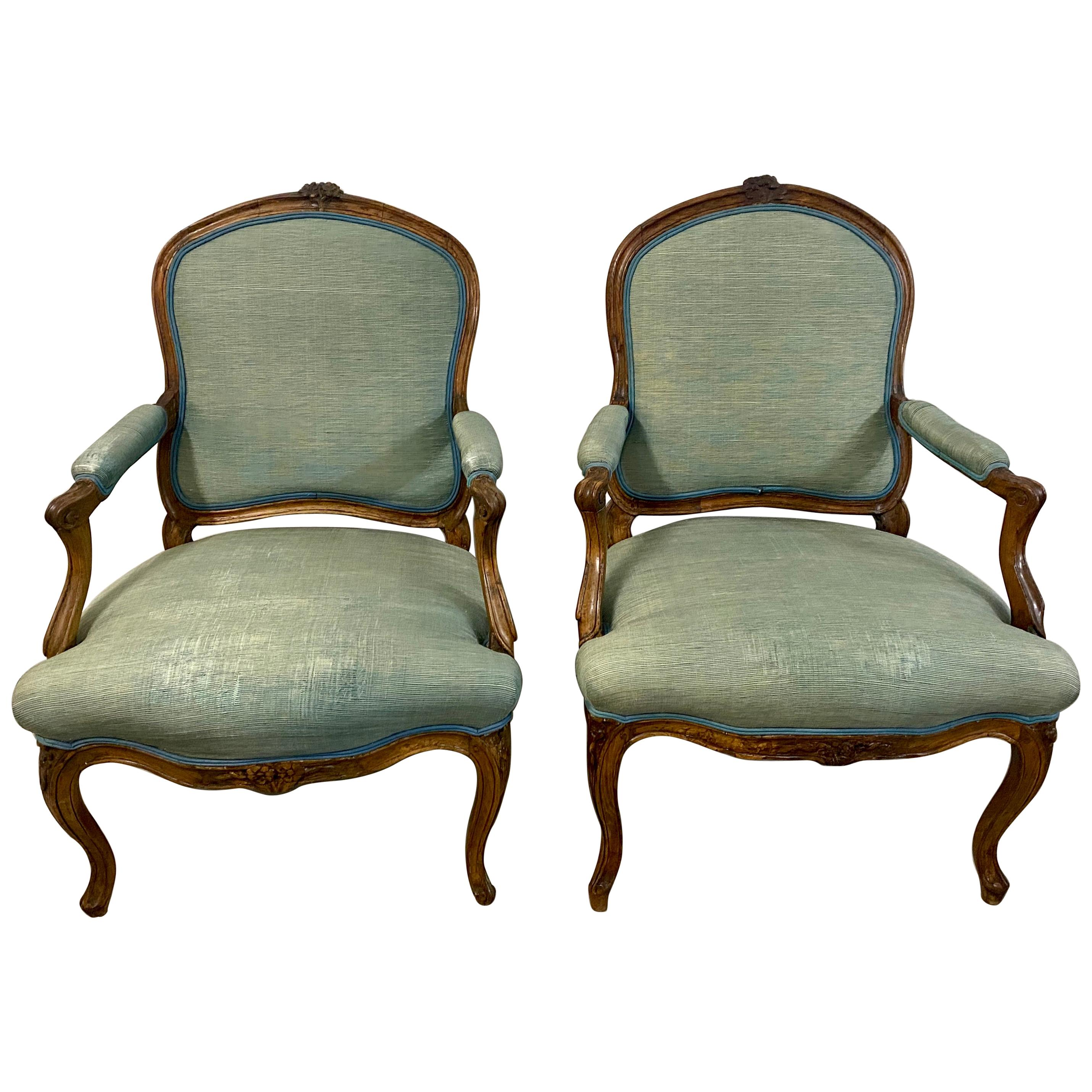 18th Century Pair of French Louis XV Carved Walnut Armchairs
