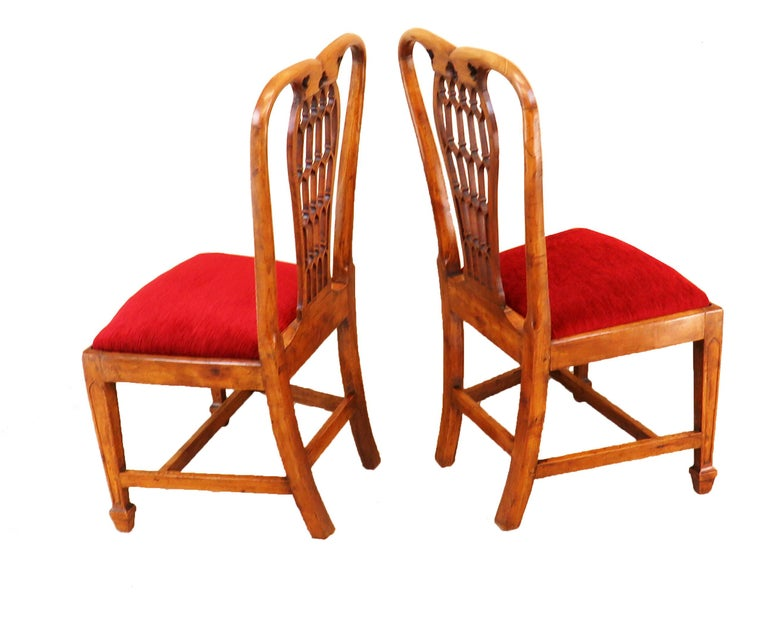 A charming pair of 18th century English fruitwood Side chairs having delightful lattice pattern pierced Fretwork backs over shaped drop in seats raised on Elegant square tapering legs with moulded Decoration and h stretcher  (The backs of