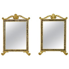18th Century, Pair of Italian Neoclassical Carved and Giltwood Mirrors