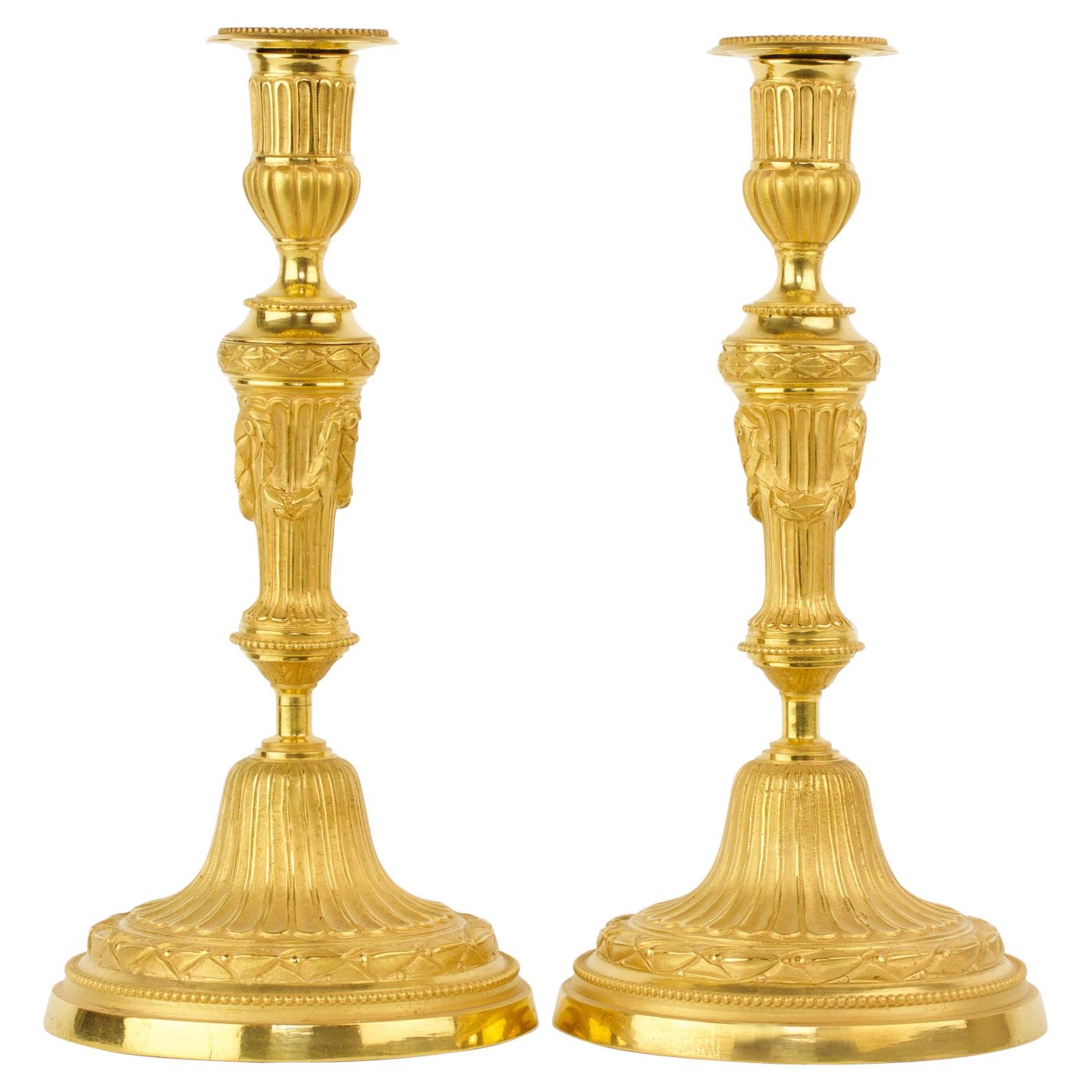 """18th Century Pair of Transition Louis XVI Gilt Bronze Candlesticks """"à la Grec"""""""