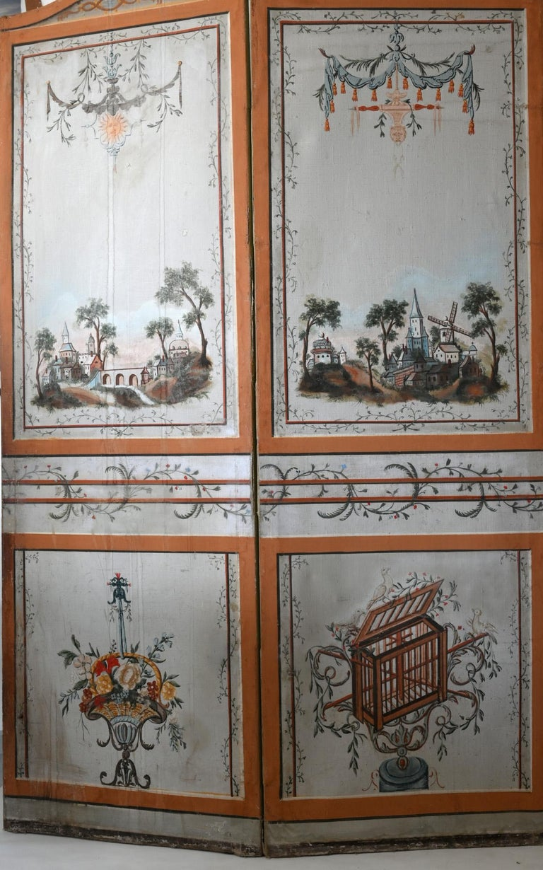 The painting of the screen is still original and on both sides. The motives are very fine and made with beautiful colors. The five-winged paravent is highly decorative and it is also possible to hang it at a wall.