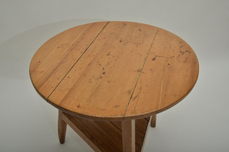18th century pine cricket table, England, circa 1780. 3-plank tabletop with chanfered legs and under shelf.
