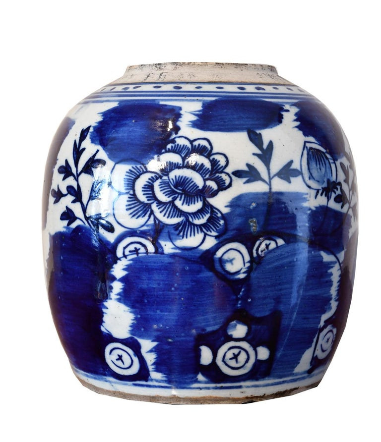 A very beautiful Chinese porcelain jar with hand-painted cobalt blue decorative elements that include a large peony blossom, which in Chinese art symbolizes beauty, rank, higher social status, luxury and opulence. Also depicted, amidst bold patches