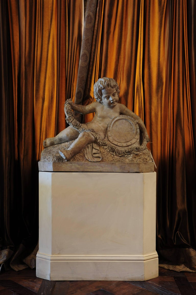 Depictions of young angelic boys are also known as putti, or putto for a single one. Since the 17th century on they remained popular and are found in various forms. Perhaps the most known version is Cupid. Looking at their attributes time periods