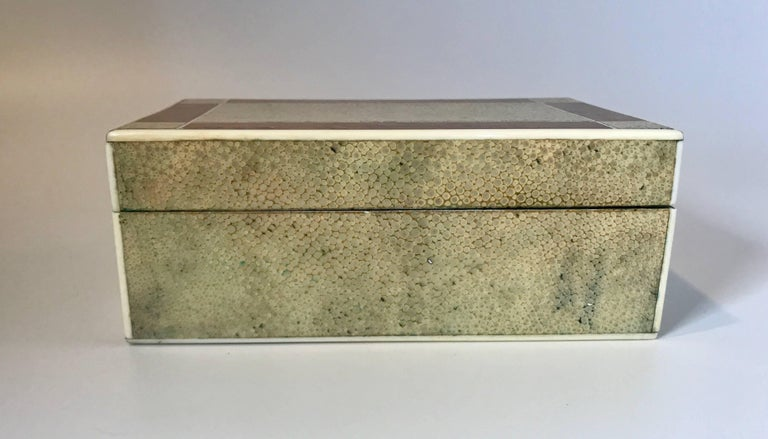 18th century Shagreen box with bone and bird's-eye maple trim in a geometric pattern on the top. The box has a wood interior.