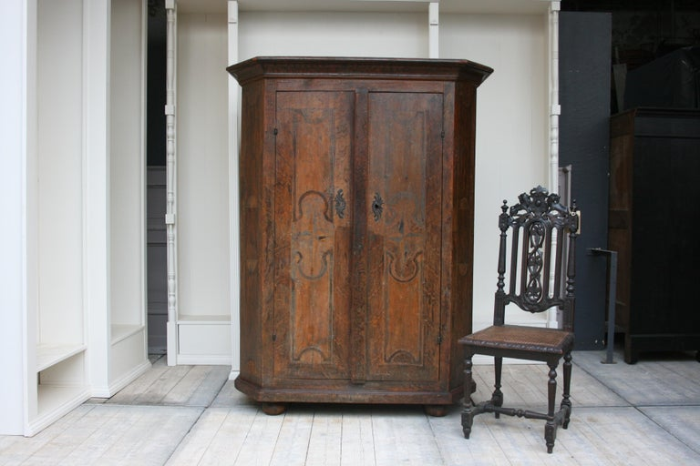 Antique South German rustic cabinet in original painting, circa late 18th century.