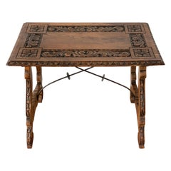 18th Century Spanish Baroque Side Table with Carved Top & Legs & Iron Stretchers
