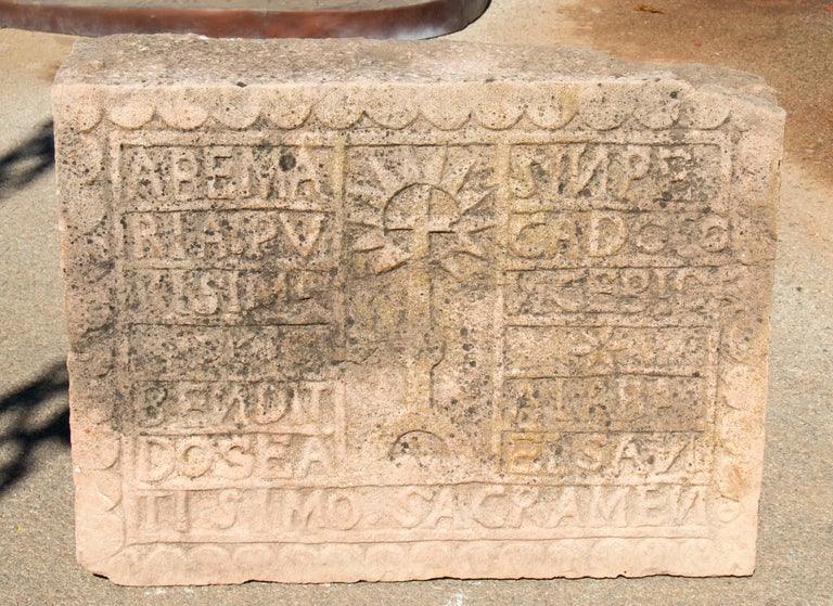 18thy century Spanish carved stone relief with date and religious inscriptions.