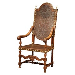 18th Century Spanish Carved Walnut Armchair with Embossed Leather and Finials