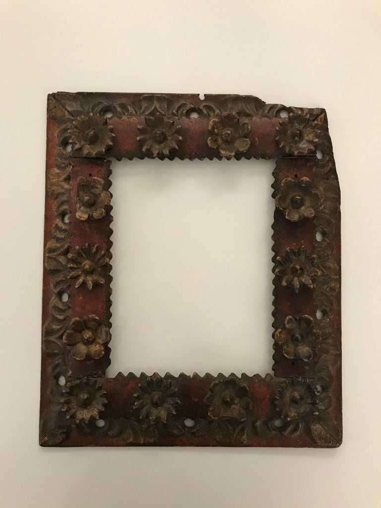 Original 18th century hand carved painted and applied ornament picture frame; continuous carved floral motif.
