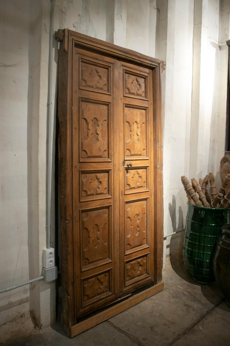 18th century Spanish hand carved paneled wooden door.   Dimensions with door frame: 255 x 126 x 10cm Dimensions without frame: 235 x 108cm.