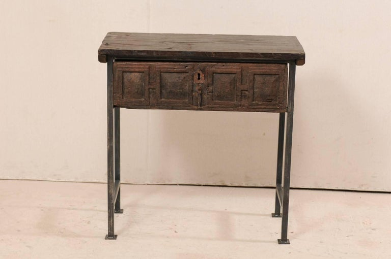 A handsome 18th century Spanish single drawer chest or table. This piece features an 18th century (or earlier) Spanish drawer which has been set into a custom iron base, with an older wood top to produce this fantastic statement piece. The top and