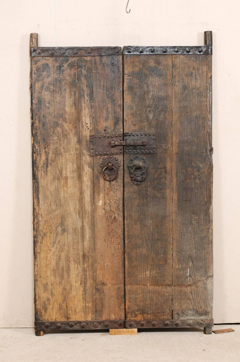 A pair of 18th century Spanish wood doors with wonderful old iron details  and hardware. - 18th Century Spanish Wood Doors With Original Iron Accents And