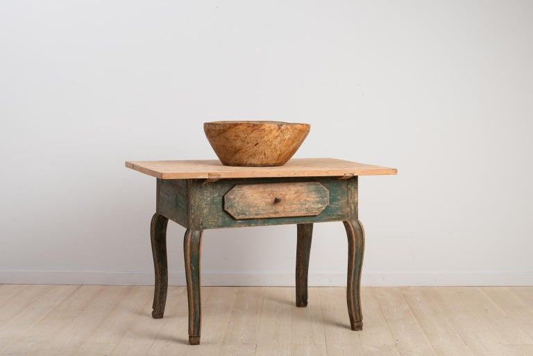 Charming Swedish baroque table with drawer and curved legs. The table is dry scraped to the first layer of paint and was manufactured during the late 1700.