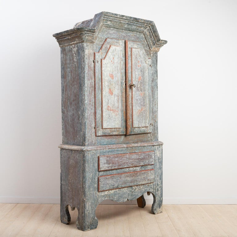 Swedish Folk Art cupboard from northern Sweden. The model is often called Lockne cupboard because they were manufactured in the area surrounding the village Lockne in Jämtland. The cupboard is dry scraped to the first layer of paint from the late
