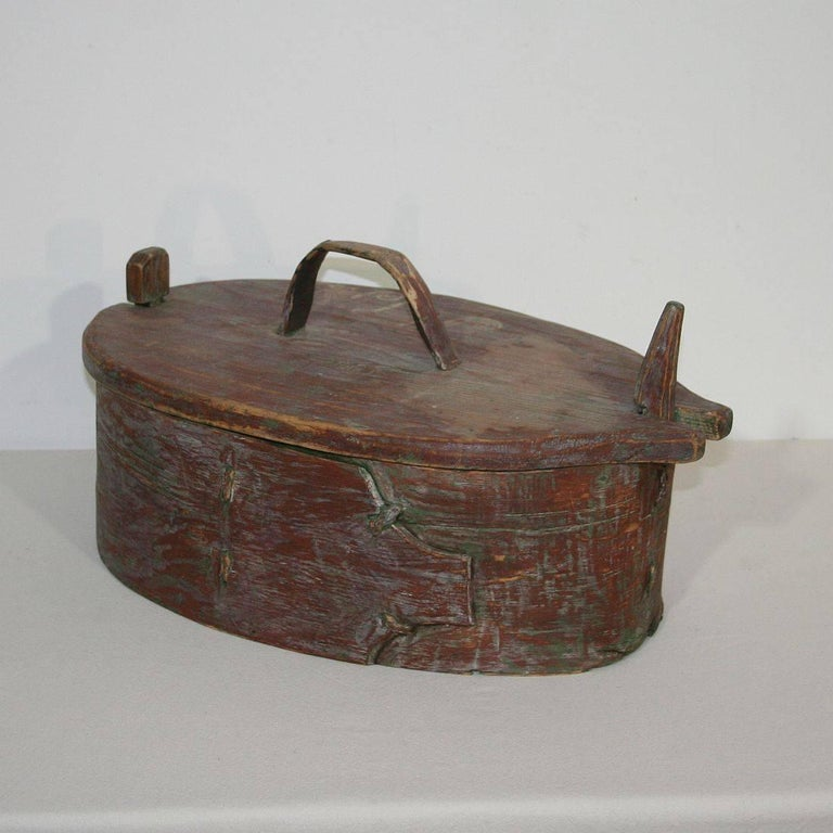 Beautiful and rare Folk Art painted bentwood box, that was once used for storage. Stunning traces of color, Sweden, circa 1750. Weathered.