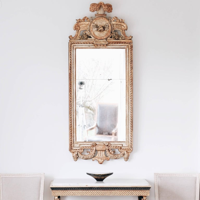 Unusually large and impressive 18th century Swedish Gustavian giltwood mirror. Signed by master mirror maker Johan åkerblad (1728-1799). With original mirror glass and gilt showing great patina, circa 1790.  Good condition with wear consistent