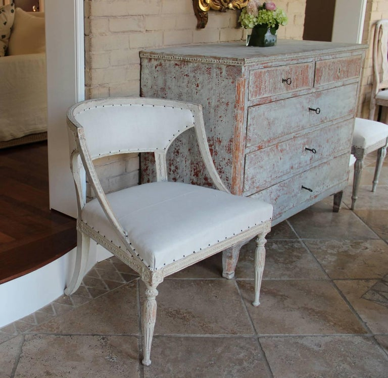 A late 18th century chair from the Gustavian period signed by the famous Swedish chair maker, Ephraim Stahl, 1767-1820, who worked in Stockholm and was one of the main furniture makers for King Gustav III of Sweden. The pale gray paint surface is