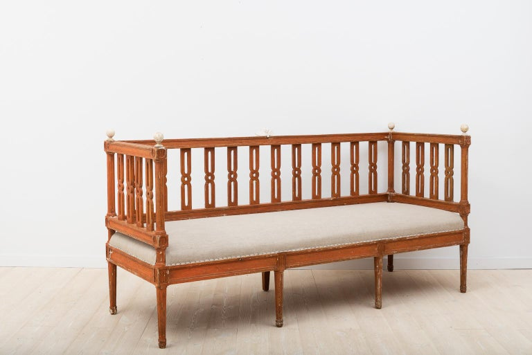 Small slender Gustavian sofa from the late 1700s that's been dry scraped down to the original paint. Renovated seat dressed in linen, Sweden, circa 1790.