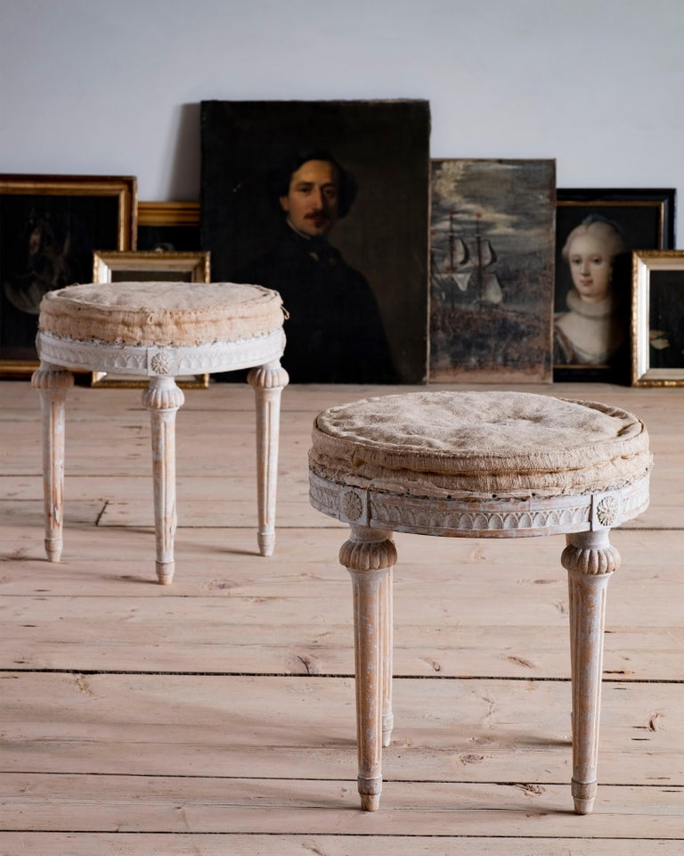 Elegant pair of Gustavian stools in their original finish and seat cushion, circa 1790, Sweden.  Very good condition with wear consistent with age and use. A detailed condition report is available on request.