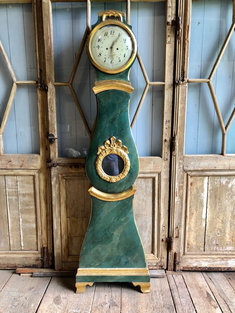 """A fine 18th century Gustavian """"Mora"""" tall-case clock from Sweden circa 1760, with painted dial and faux marble painted case with parcel gilt decoration."""