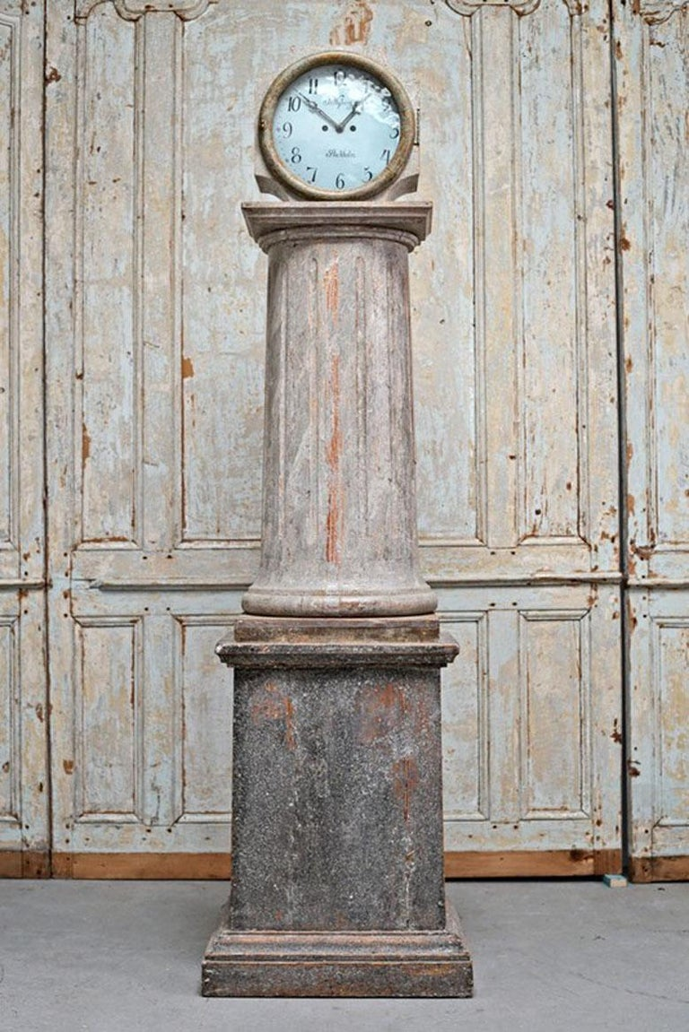 An exceptionally rare and fine Swedish early neoclassical period long case clock with fluted center column from the mid 18th century retaining its original blue paint surface, signed. The high quality movement is stamped J. Nyberg - Stockholm. J.