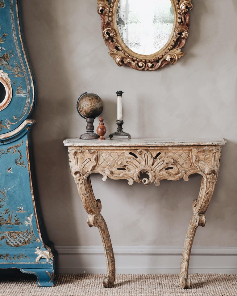 Exceptional and unusual 18th century Swedish Rococo console table in its original color, with fine carvings and proportions, circa 1760.   Good condition with wear and tear consistent with age and use.