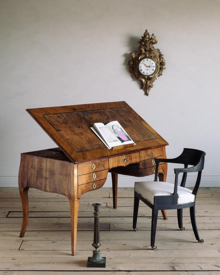 Most unusual and remarkable Swedish Rococo period metamorphic draughtsman's table with seven drawers, adjustable hinged top with book rest and retractable candle holders, circa 1760 Stockholm, Sweden.  Good condition with wear consistent with age