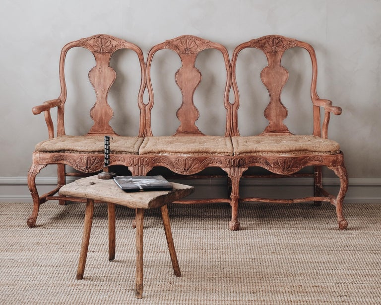 Fine 18th century Swedish Rococo three seat sofa/bench with fine carvings, original color, and padding. ca 1750.   Good original condition with wear and tear consistent with age and use.