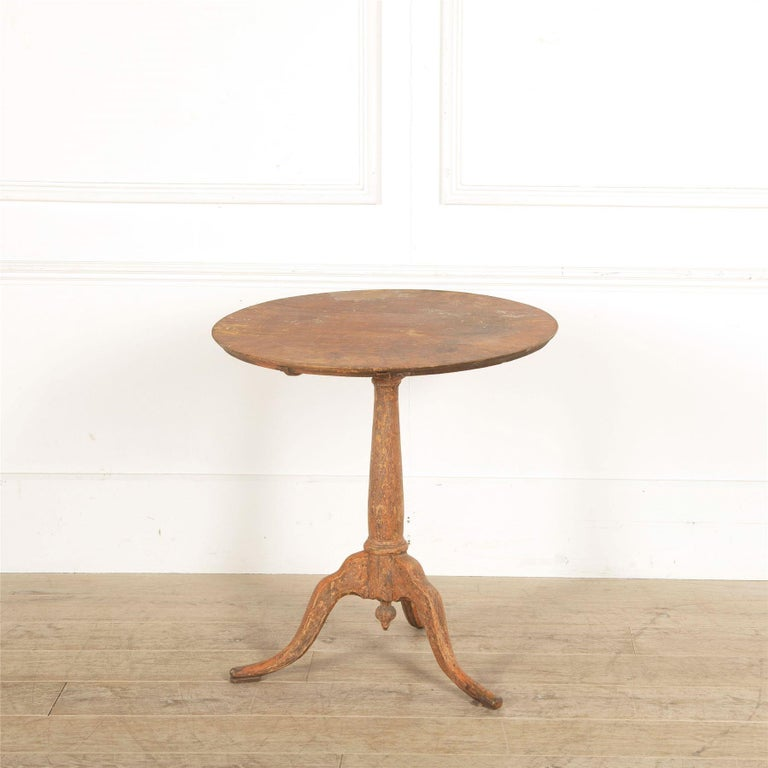 An 18th century Swedish tilt-top table scraped to original paint.